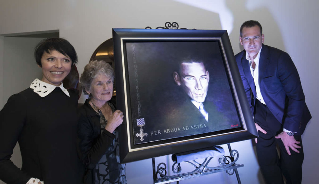 Acclaimed Artist - Anna Rubin, Travis Schultz's Mum - Denise Schultz and Travis Schultz with a painting of Travis's grandfather - Jack O'Brien, at the launch of Travis Schultz & Partners in 2018.