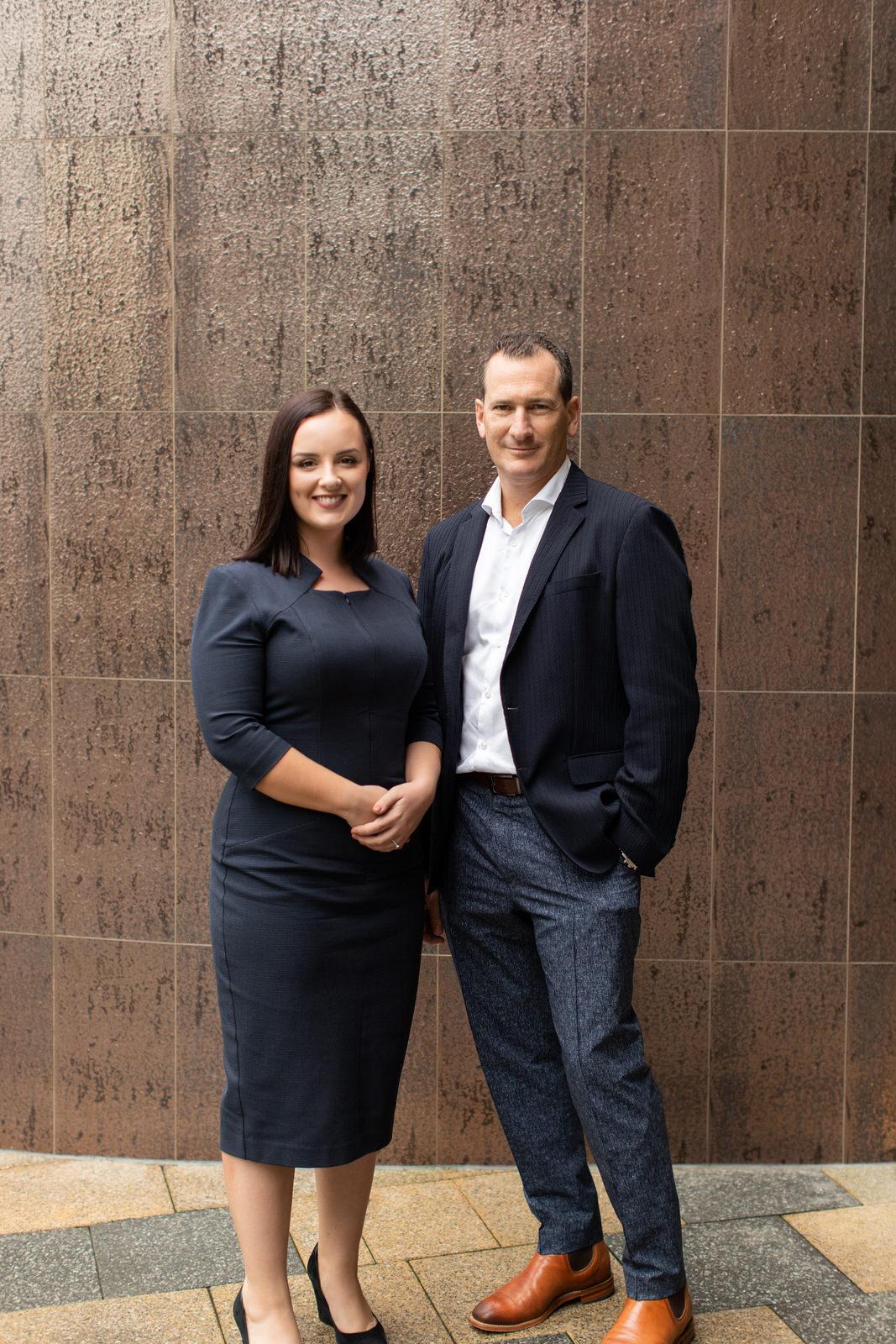 Jemma Barnard standing with Travis Schultz
